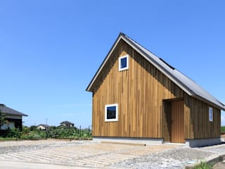 Casas de estilo ecléctico de 株式会社プロトハウス事務局 Ecléctico