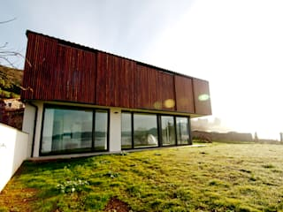 Country style houses by RUBIO · BILBAO ARQUITECTOS Country
