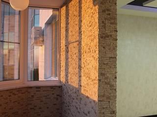 Moderner Balkon, Veranda & Terrasse von Студия интерьерного дизайна happy.design Modern