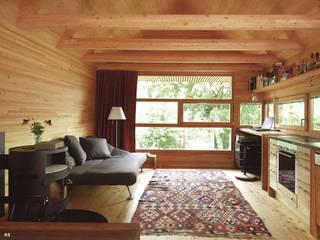 Wohnraum mit Küche: minimalistische Wohnzimmer von ARCHITEKTURBÜRO KADEN