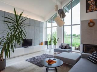 PROJEKT WNĘTRZA DOMU JEDNORODZINNEGO: styl , w kategorii Salon zaprojektowany przez Kunkiewicz Architekci