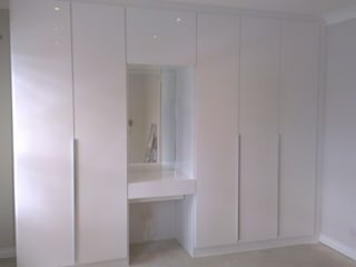 White Gloss Fitted Wardrobes with Contrasting Internals :  Bedroom by Metro Wardrobes London