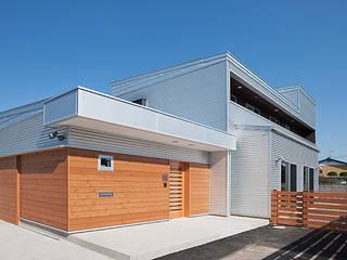 Modern houses by 株式会社デザインスタジオ麦工房 Modern