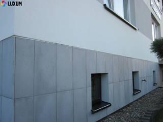 Modern houses by Luxum Modern