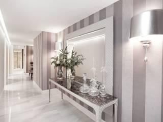 Diseño de vivineda alto standing en Barcelona INEDIT INTERIORISTAS Pasillos, vestíbulos y escaleras de estilo clásico Beige