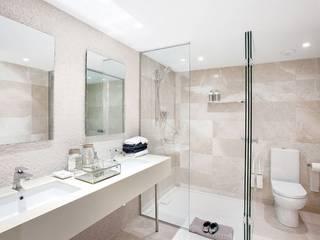 Baño principal en Pedralbes, Barcelona: Baños de estilo  de INEDIT INTERIORISTAS