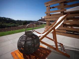Terraço Exterior: Hotéis  por Tralhão Design Center