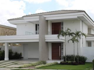 Casa MM: Casas  por Flavio Monteiro Arquitetos Associados