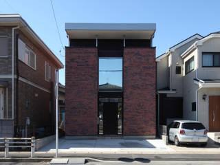一級建築士事務所アトリエm Eclectic style houses Bricks