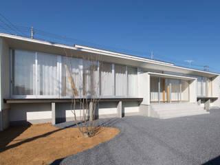 Casas de estilo ecléctico de 有限会社 宮本建築アトリエ Ecléctico