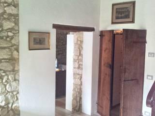 CASA BRAGGIO TRIBERTI Ingresso, Corridoio & Scale in stile rustico di Studio Architetto Grella Rustico