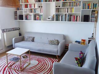 Décoration d'un séjour – Vitry/Seine:  de style  par L'Home Agencée