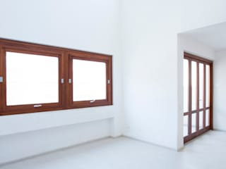 EDIFICIO RESIDENZIALE E NEGOZIO A BALESTRATE Pareti & Pavimenti in stile moderno di AM3 Architetti Associati Moderno