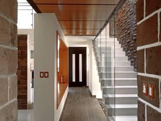 Corridor & hallway by Home & House Studio , Country