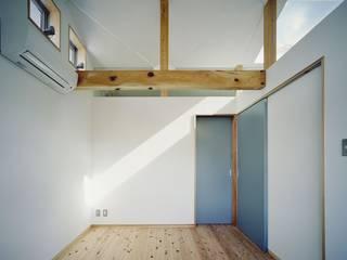 DK House: 吉元一成アトリエが手掛けた寝室です。