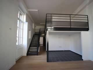 LOFTS DANS UNE ANCIENNE BANQUE DE FRANCE Salon moderne par DDB ARCHITECTURE Moderne