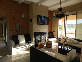 Salones de estilo  de ART quitectura + diseño de Interiores. ARQ SCHIAVI VALERIA