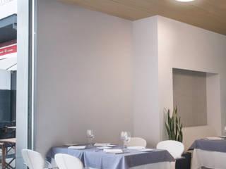 Modern Dining Room by Pujol Iluminacion Modern