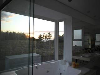 Baños de estilo  de Super StudioB, Moderno
