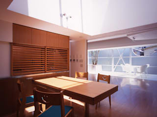 Modern dining room by Guen BERTHEAU-SUZUKI Co.,Ltd. Modern