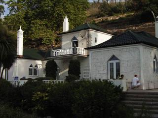 Facade Renovation - A RenoBuild Algarve Casas de estilo rural