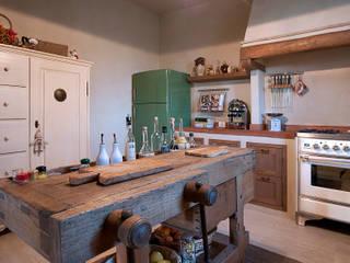 Rustic style kitchen by marco bonucci fotografo Rustic