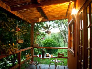 Deck Varandas, marquises e terraços rústicos por Jaqueline Vale Arquitetura Rústico