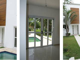 Residência Modernizada: Salas de estar  por Daniela Zuffo Arquitetura e Interiores