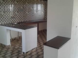 open kitchen:  Kitchen by NISHA MIDAS CONSTRUCTION