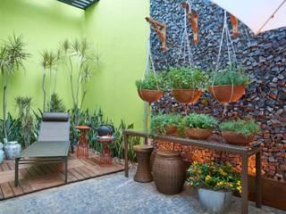 Mostra de Ambientes de Sete Lagoas - Cozinha Gourmet e Área Livre de Lazer: Jardins  por Lider Interiores,Moderno