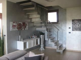 Nichelino - progetto di interni Ingresso, Corridoio & Scale in stile moderno di Studio Paolo Padovan architetto Moderno