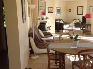 Rénovation d'un espace salon/salle à manger : changement du sol au plafond par Atelier[21]