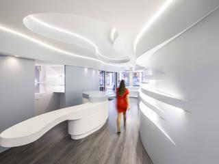 Novaoptica - Guimarães: Escritórios e Espaços de trabalho  por Tsou Arquitectos