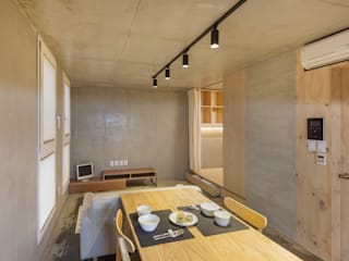 Woonam Urban Housing: Strakx associates 의  다이닝 룸