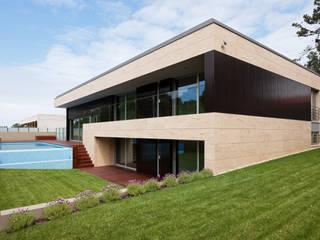 Casa AA_1: Casas  por XYZ Arquitectos Associados