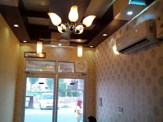 Ceiling and wall designing using pvc wall panels, wallpaper and led lights etc.. Modern study/office by Mohali Interiors Modern