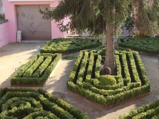 Jardim de habitação particular no Porto Jardins rústicos por Neoturf Rústico