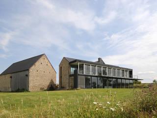 Réalité: Maisons de style  par Luc Spits Architecture