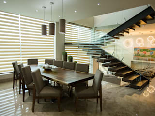 Comedor. Comedores modernos de Dovela Interiorismo Moderno Madera maciza Multicolor