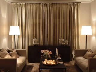 soggiorno: Soggiorno in stile  di conscious design - interiors