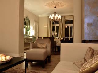 soggiorno sala pranzo: Sala da pranzo in stile  di conscious design - interiors