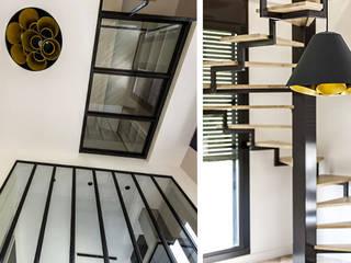 Projet D2: Couloir et hall d'entrée de style  par ateliereb