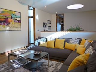 homify Living roomSofas & armchairs Textile Yellow