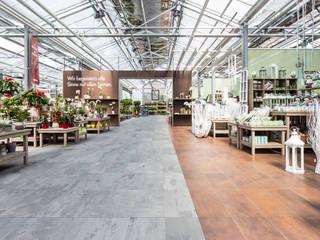 Gartencenter bellaflora Austria Moderne Ladenflächen von Ceramiche Refin S.p.A Modern