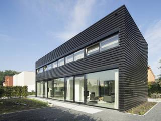 Ontwerp vrijstaand woonhuis particulier Industriële huizen van JMW architecten Industrieel