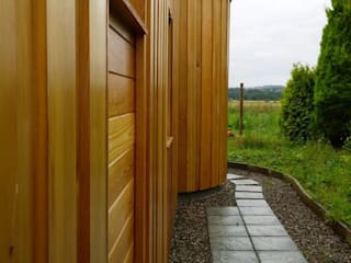 Timber clad extension: modern Houses by Architects Scotland Ltd