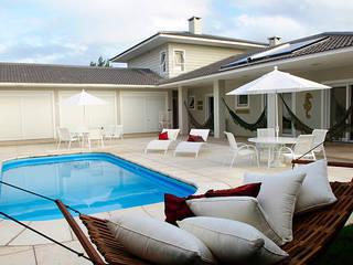 Casa de Praia em Xangri-lá - RS: Casas  por Londero Moraes Arquitetura & Design