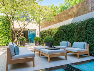​Back garden at Bedford Gardens House. Modern garden by Nash Baker Architects Ltd Modern