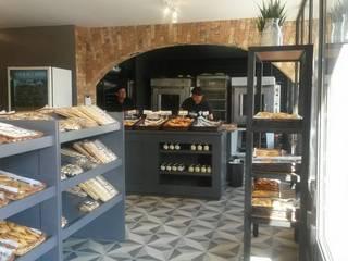 Panaderías La Artesa Espacios comerciales de estilo rústico de Purista Interiorismo Rústico