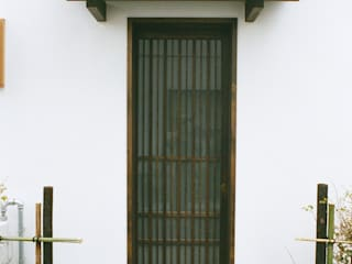 Asian style window and door by kOGA建築設計室 Asian